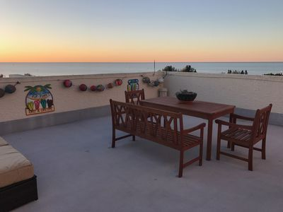 Enjoy entertaining outside on our 800 sq ft private roof top patio & teak dining