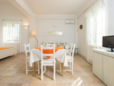 Photo for Cozy apartment in a residence immersed in a green paradise, for families or small group of friends