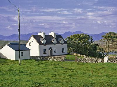 Photo for Traditional, renovated farmhouse, with extensive views of rugged South Connemara countryside t…
