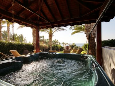 Photo for Beach Front Villa with Hot Tub  sleeps 8/10 people (also available as a sleep 6)