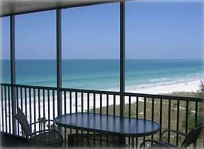 Photo for View Panoramic Sunsets from This Luxurious Beachfront Condo