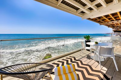Private ocean front patio with color accents in keeping with the easy living lifestyle here.