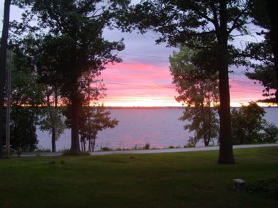 Photo for Waterfront, private beach and sunset view. 1 bedroom, kitchen, fireplace