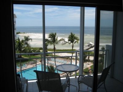 Enjoy inside and outside views of the pool and the Gulf!
