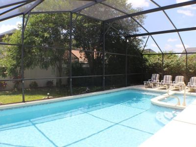 Photo for Deluxe 4 bed 3 bath pool & spa home with free bbq and fenced back garden at the prestigious Indian Creek near Disney, Orlando