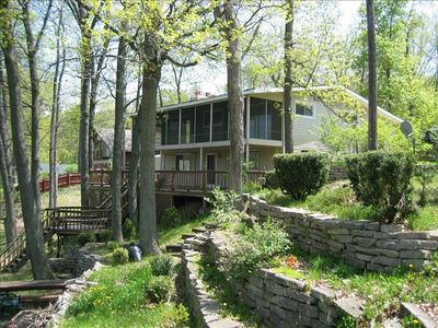 Nestled in tall majestic Oaks on the lake and accrosed from State Park