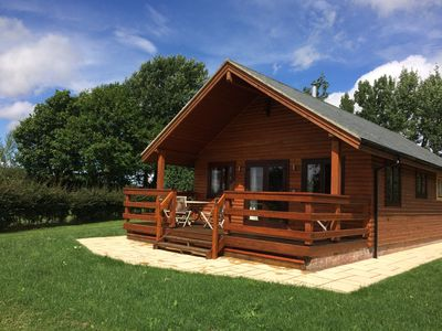 The chalet with outdoor dining table and chairs