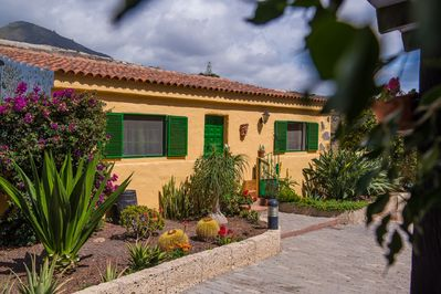Front entrance and garden at Finca Eden. Driveway has space for two vehicles.