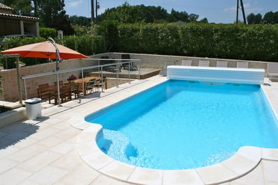 Heated pool with sunken eating area