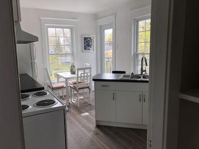 Sunny bright kitchen with a large walk-out deck