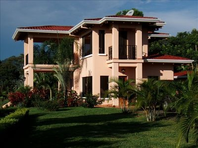 Photo for Private villa with lush tropical garden and big heated pool