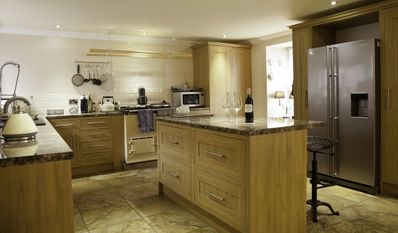 Fully fitted kitchen with AGA cooker