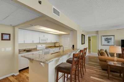Breakfast bar with seating for three. Kitchen is  open to living & dining area!