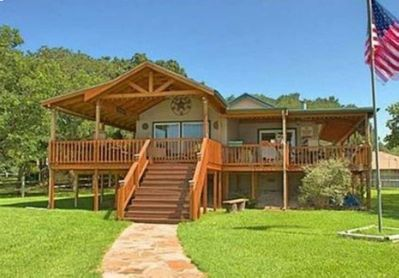 Wrap around porch provides a great lakefront view!