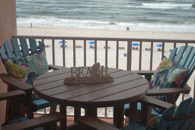 New patio furniture on the balcony with a beautiful view of the gulf.