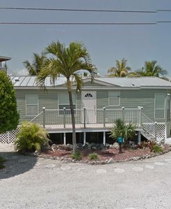 Bring your Flip-Flops to this spacious tranquil home on a canal and bay view.