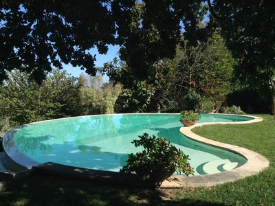 Photo for Immersed in the green countryside 12 km. from Rome with pool