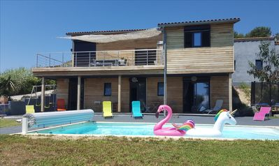 Photo for Contemporary wooden villa with sea view and swimming pool between Nice and Monaco!