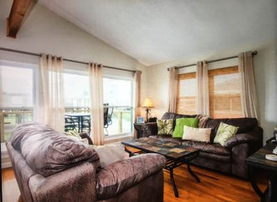 Enjoy the view to the beach through expansive windows in the living room.