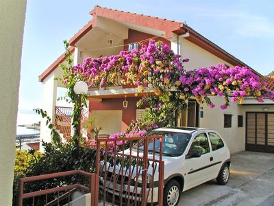 Photo for Holiday apartment with garden terrace and sea view