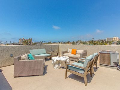 Photo for Dog-friendly home - three blocks from beach w/ boogie board, bikes, & roof deck