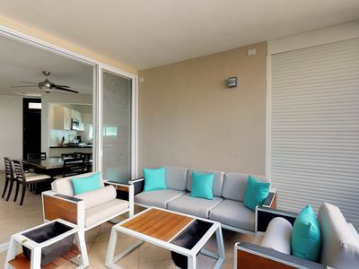 Photo for NEW LISTING! Comfortable condo w/ shared pool & entertainment - drive to beach