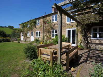 Photo for 10 mins to beach, 5 mins to Bridport. Lovely views, plenty of space inside & out