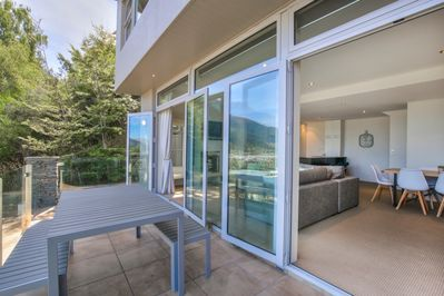 Two sets of double sliding doors onto the balcony