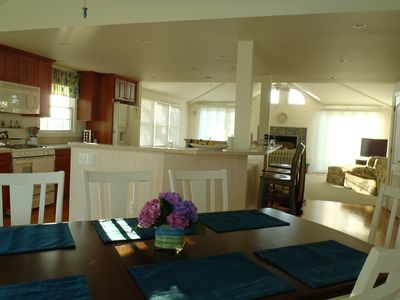 """This is a """"shotgun"""" view of the light and bright upstairs living area."""