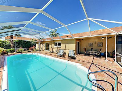 Photo for New Listing! Upscale Oasis w/ Screened Pool & Patio - Close to 2 Beaches