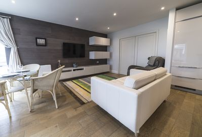 Sliding doors separate bedroom from sitting area