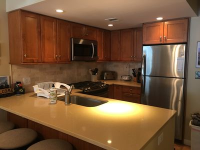 Fully equipped updated kitchen with stainless steel appliances