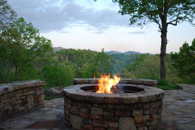 Natural stone firepit at the front of house. Enjoy relaxing and making smores.