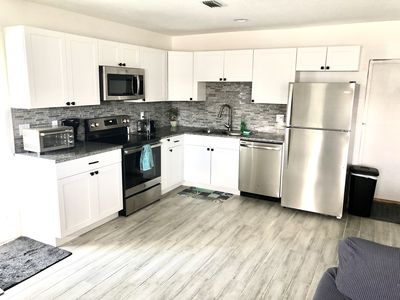 Photo for 5 min drive to beach and walking distance to downtown gardens/whole foods
