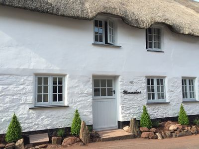Photo for A newly renovated 300 year old Thatched cottage in the heart of a pretty village