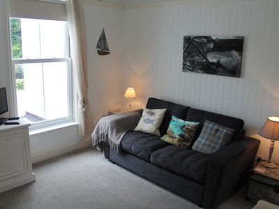 Photo for Attractive retreat for 2 close to beach and village. Sit outside and look at the sea!