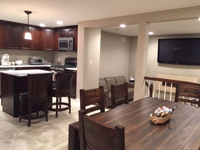 Ground level kitchen, living room, and dining area.