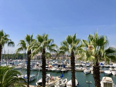 Photo for Modern apartment in a marina with views of St. Tropez
