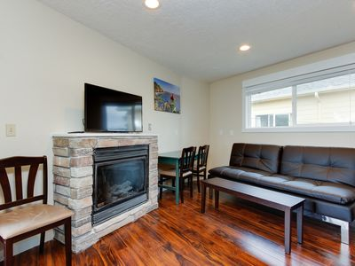 Photo for Upper-level, dog-friendly condo with private balcony & nearby beach access!