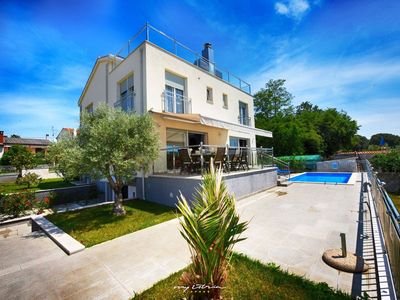 Photo for Stylish villa with roof terrace and sea view