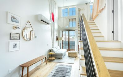 Photo for Stay with Lucky Savannah: Loft Style Apartment with River Skyline Views