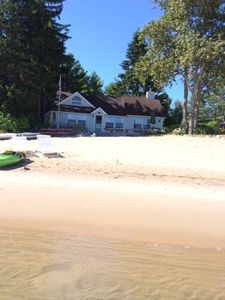 Photo for Walk to Village! Suttons Bay Sandy Beach Waterfront Cottage.