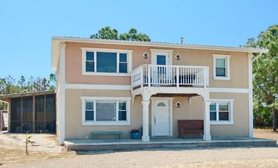 Photo for Bayfront Ground-level Living, and walk to the beach! 2019 remodel, screen porch, pet friendly w/ free wifi and Beach Gear