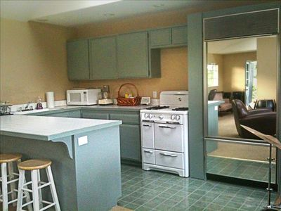 Kitchen with all amenities including bar seating and brand new Sub Zero fridge.