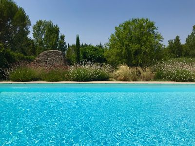 Photo for Stone house between Gordes and Goult, for 10 people, secured pool / heated