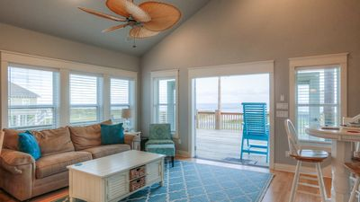 View from living room with French Doors open to the huge deck and beach view.
