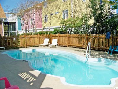 Photo for Enjoy the beach by day and the pool by night in this premier townhouse