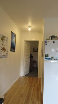 Hallway to bedroom provides a pleasant apartment feel
