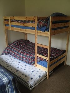 Bedroom #2 on the first floor.  Bunk beds with pullout bed and additional twin.