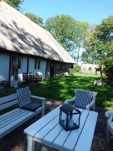 Photo for Family holidays in a thatched monument on a spacious garden plot